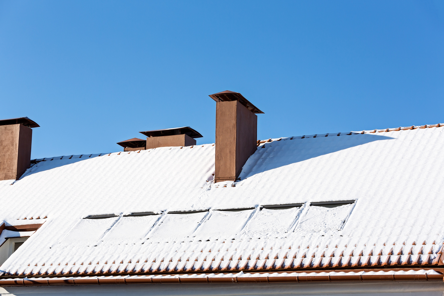 Snow collected on rooftops is a major source of snow melt moisture intrusion at the end of winter.