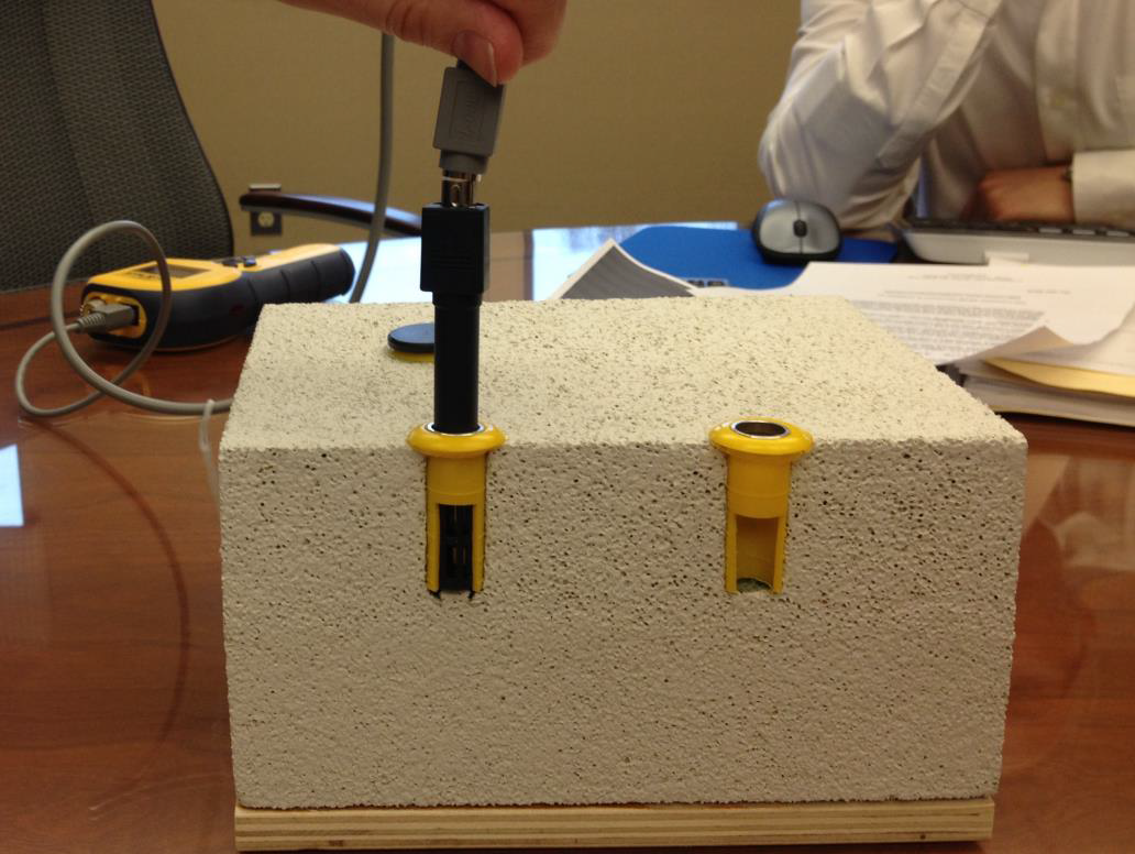 Thermo-hygrometer probes in a cross-section of concrete.