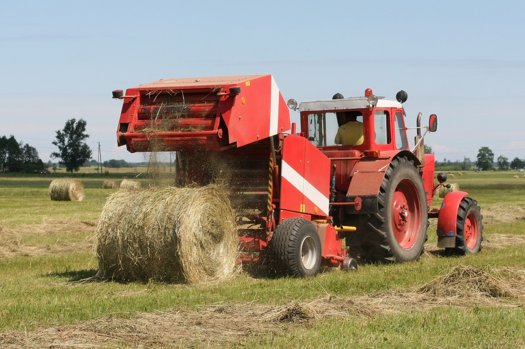 Modern technology such as the automated hay baler and the tractor make harvesting hay much more efficient than ever before.