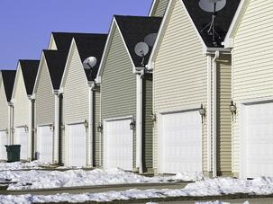 Building conformity Row of nearly identical one-car garages in winter.jpeg